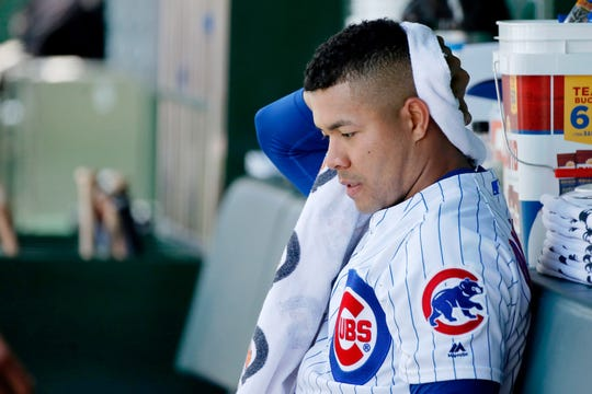 Jun 22, 2019; Chicago, IL, USA; Chicago Cubs starting pitcher Jose Quintana (62) wipes off his head in the dugout during the first inning of his game against the New York Mets at Wrigley Field.