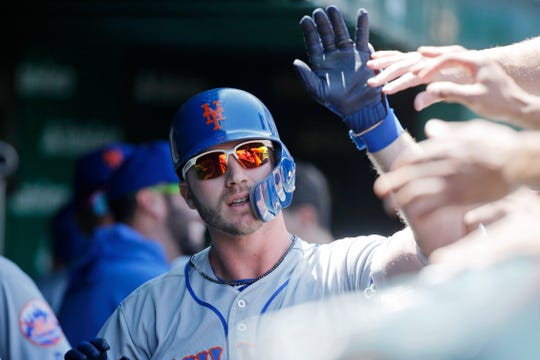Jun 22, 2019; Chicago, IL, USA; New York Mets first baseman Pete Alonso (20) is congratulated in the dugout after hitting a home run against the Chicago Cubs during the first inning at Wrigley Field.
