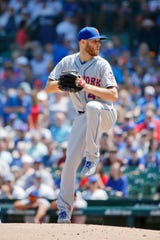 Jun 22, 2019; Chicago, IL, USA; New York Mets starting pitcher Zack Wheeler (45) pitches against the Chicago Cubs during the first inning at Wrigley Field.