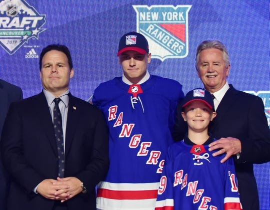 Jun 21, 2019; Vancouver, BC, Canada; Kaapo Kakko poses for a photo after being selected as the number tow overall pick to the New York Rangers in the first round of the 2019 NHL Draft at Rogers Arena.