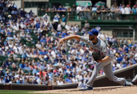 New York Mets starting pitcher Zack Wheeler throws against the Chicago Cubs during the first inning of a baseball game in Chicago, Saturday, June 22, 2019.