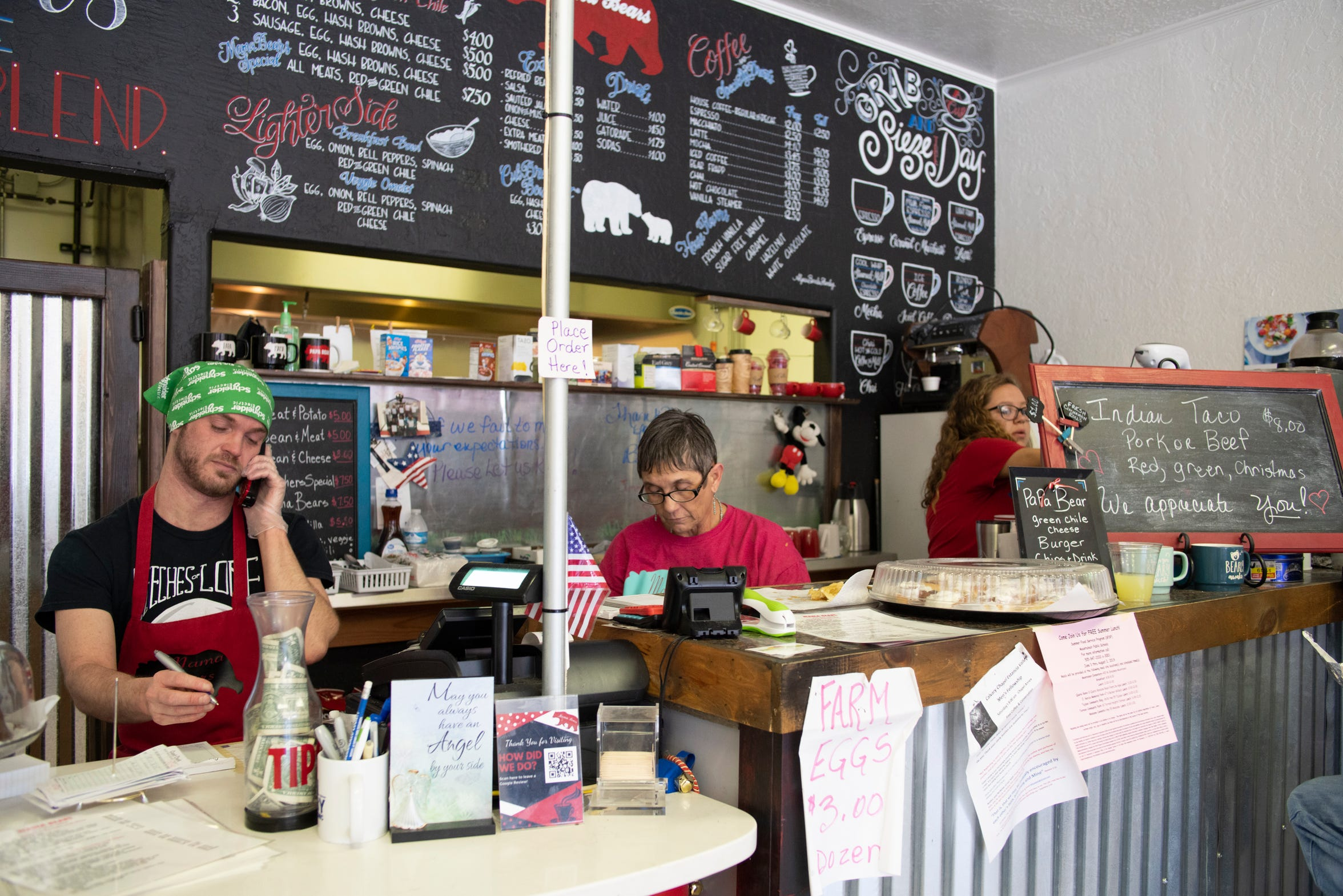 Kathy Swope and workers behind the counter in Mama Bears Café in Estancia.