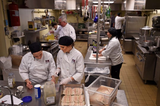 Belle Morrow, center, Paloma Villalobos, left, and Ashley Lucas, students of the School of Hotel, Restaurant and Tourism Management at New Mexico State University, prepare meals during a class with assistant professor and chef John Hartley at 100 West Cafe's kitchen. The J. Willard and Alice S. Marriott Foundation recently awarded the NMSU Foundation with $400,000 to support the School of HRTM.