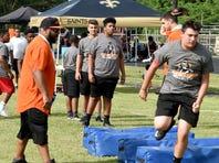 PHOTOS: Devery Henderson Football Camp