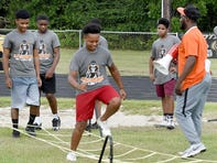 Devery Henderson football camp returns to help build athletes