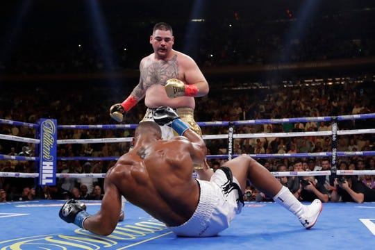 Andy Ruiz, above, knocks down British boxer Anthony Joshua during the third round of a heavyweight championship boxing match Saturday, June 1, 2019, in New York. Ruiz stopped Joshua in the seventh round. (AP Photo/Frank Franklin II)