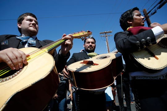 Mariachis play music for heavyweight champion of the world, Andy Ruiz Jr., during a parade in honor of Ruiz in Imperial, California on June 22, 2019.