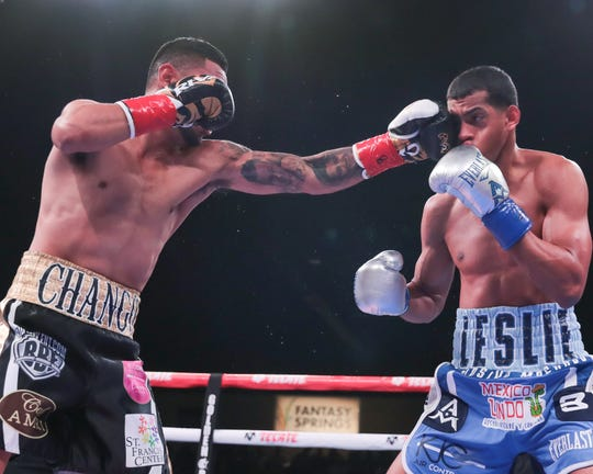 Andrew Cancio, left, throws a left hook at Alberto Machado during their world championship bout at Fantasy Springs Resort Casino on June 21, 2019.