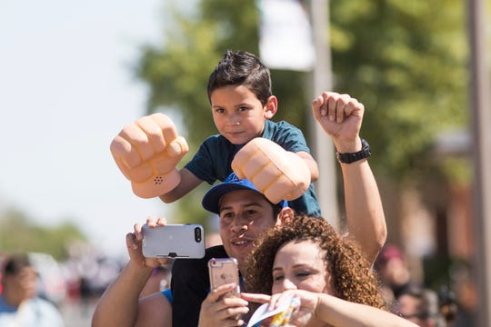 Gianni Castañeda, 5, tries to get a look at  heavyweight champion of the world, Andy Ruiz Jr., during a parade in honor of Ruiz in Imperial, California on June 22, 2019.