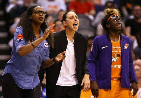 Phoenix Mercury's Camille Little and Diana Taurasi react against Las Vegas Aces in the second half during the home opener on May 31.