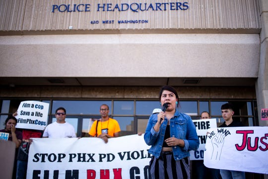 Viri Hernandez of Poder in Action speaks during a protest on June 21, 2019, outside Phoenix Police Department Headquarters in Phoenix.