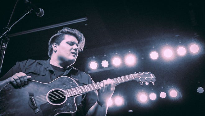 Wade Cota on stage at the Marquee Theatre in Tempe.