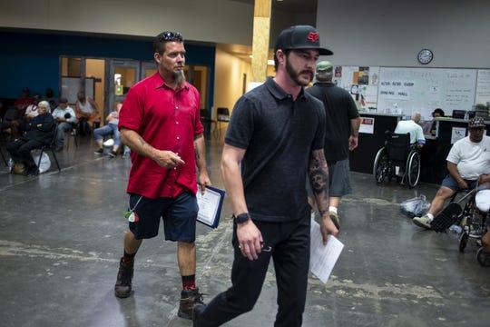 Joe Zenko (left) and Westin Schuetz, an assistant program coordinator at The Crossroads, leave Maricopa County Homeless Court on June 18, 2019.