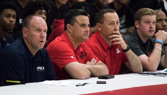 Northern Arizona assistant coach Shane Burcar and Arizona head coach Sean Miller and others watch the Millennium-Mater Dei game during the Section 7 Basketball tournament at Brophy Prep High School in Phoenix, Friday, June 21, 2019.