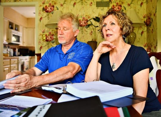 Dr. Greg Foy, left, an associate professor in chemistry at York College, and his wife Leigh Foy, a science teacher at York Suburban High School, discuss their upcoming climate change workshop during an interview at their home in Spring Garden Township, Thursday, June 20, 2019. Dawn J. Sagert photo