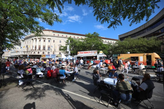 Main Street is full of people eating and enjoying the weather during opening night of CGI Rochester International Jazz Festival.