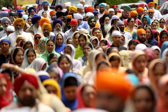 People walk in the Sikh Day Parade beginning at the Dasmesh Darbar Sikh Temple in Salem on June 22, 2019.