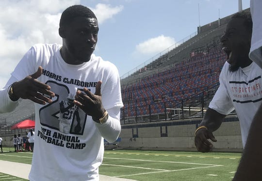 Former LSU standout Morris Claiborne earns a laugh at his Saturday camp.