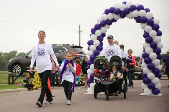 Karen and Tom Cota begin the first-ever Sioux Falls Walk to End Epilepsy with their family on Saturday at the GreatLIFE Performance and Fitness Center. Karen and their son, Hayden, both have epilepsy.