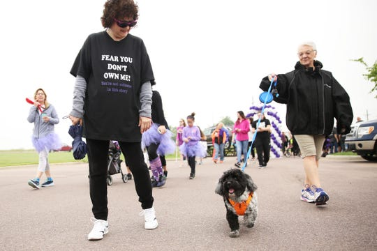 Zeb and his owner Gita Henricks walk in the first-ever Sioux Falls Walk to End Epilepsy Saturday at the GreatLIFE Performance and Fitness Center. The two were walking in support of Team Mak.