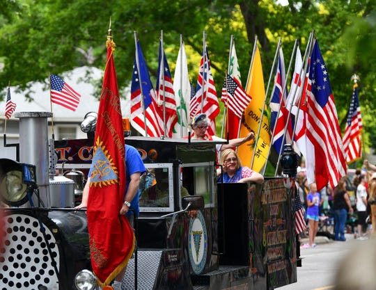 Colorful flags signal the start of the Rapids River Days Parade Friday, June 21, in Sauk Rapids.