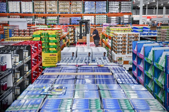 Hundreds of packages of merchandise are put into place Tuesday, June 18, at the new Costco Wholesale 160,000-square -foot membership warehouse in St. Cloud.
