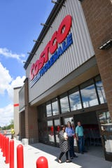 Store managers stand near the entrance Tuesday, June 18, of the new Costco Wholesale 160,000-square-foot membership warehouse in St. Cloud.
