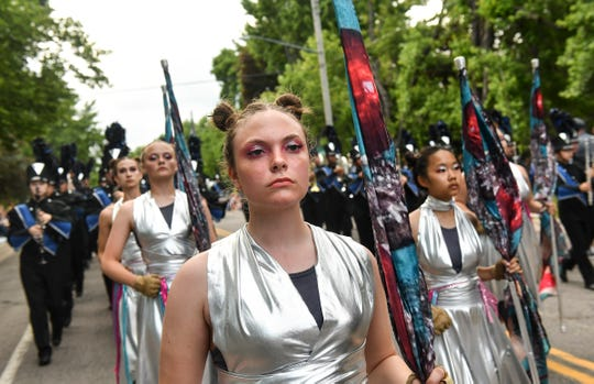 Owatonna Marching Band members march along the route during the Rapids River Days Parade Friday, June 21, in Sauk Rapids. The Owatonna band earned first place, as well as best color guard and best percussion, in Class AAA.