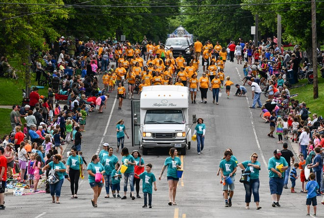 Parade participants make their way down the route during the Rapids River Days Parade Friday, June 21, in Sauk Rapids.