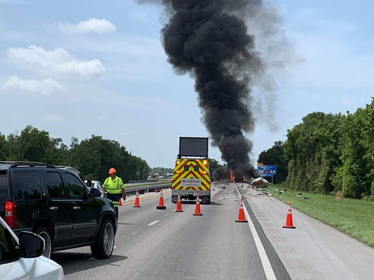 A flaming vehicle blocked traffic on Florida's Turnpike Saturday