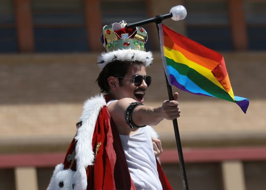 A Freddie Mercury impersonator entertains the crowd at the Pride Parade on Saturday morning, June 22, 2019, in Downtown El Paso.