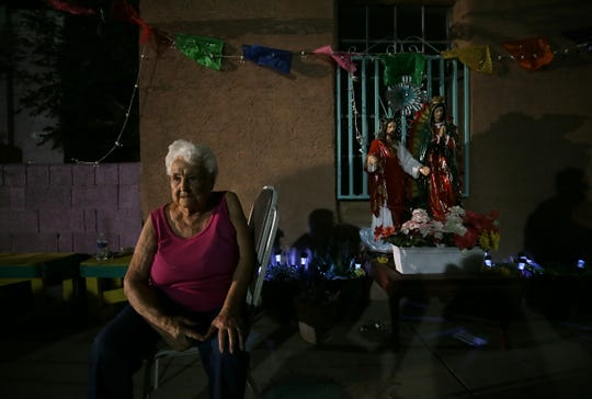 Antonia Morales sits on the sidewalk Friday night, June 21, 2019, in front of the apartment complex where she is the lone resident in the Duranguito neighborhood of Downtown El Paso. A neighbor lives next door in a house. An emergency motion for relief was granted Saturday morning by the Texas Supreme Court after an injunction against demolition was lifted Friday evening.
