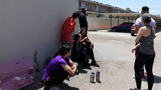 Rebeca Lopez, at left, with her cockatiels and canaries after eight units were impacted by an apartment fire in the 1300 block of Althea Court in Oxnard on June 22, 2019. It was the second fire to hit the complex in a little over 12 hours.
