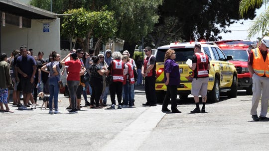 Displaced residents get help from the Red Cross after a fire at an apartment complex in the 1300 block of Althea Court in Oxnard on June 22, 2019. It was the second fire to hit the complex in a little over 12 hours.