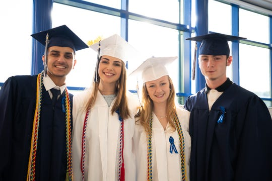 Putnam Valley High School Class of 2019 graduates, left to right, Luke Zadrima, Ashley Stockinger, Jenna Staten, and Quinn Strang celebrate their commencement ceremony in Putnam Valley, June 21, 2019.