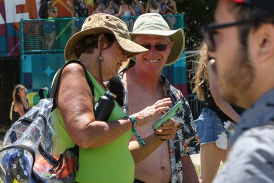 Fan wander the Firefly Music Festival in Dover on Saturday, June 22, 2019. Older folks are becoming a rarer sight at the festival as it's recently targeted younger fans.