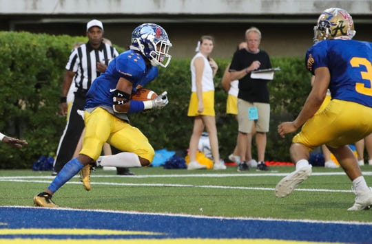 Blue's Zion Carr of Brandywine snags a pass at the goal line before returning it 100 yards in the second quarter of the DFRC Blue-Gold All-Star Football Game Friday at Delaware Stadium.