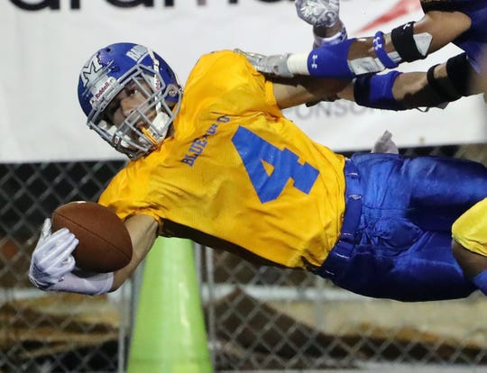 Gold's Gabe Wescott of Woodbridge comes down with a one-handed touchdown reception in the third quarter of Gold's 38-24 win in the DFRC Blue-Gold All-Star Football Game Friday at Delaware Stadium.