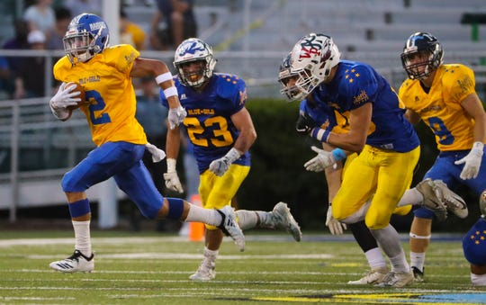 Gold's Gabe Wescott of Woodbridge gets free on a 72-yard kickoff return late in the second quarter of the DFRC Blue-Gold All-Star Football Game Friday at Delaware Stadium.