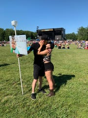 Evan Kelly (left) and Gillian Rizza (right) at The Woodlands moments after the two got engaged in the campground Friday at Firefly Music Festival in Dover.