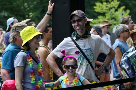 "Jen and Arlo Hornton watch Tank and the Bangas with their daughter Annabell at the Firefly Music Festival in Dover on Saturday. ""When we came three years ago there were a lot more families,"" said Arlo."