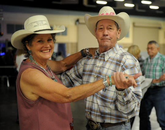 Kathryn Burch and Kayo Strickland dance to the music of Bobby Flores & the Yellow Rose Band at the Legends of Western Swing Music Festival Saturday, June 22, 2019, in the Ray Clymer Exhibit Hall.