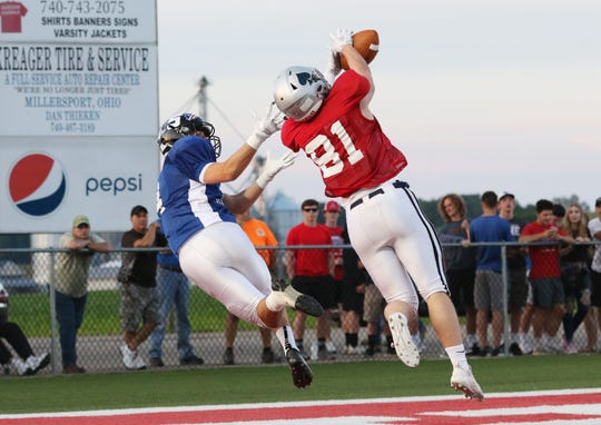 Granville graduate Cooper Campbell makes a diving interception during last Friday's Licking-Muskingum All-Star Game at Sheridan. Six Blue Aces contributed to Licking County's 27-21 victory.
