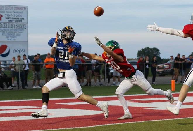 Muskingum Valley's Blayze Taylor pulls in a touchdown pass against Licking County during the Muskingum Valley-Licking County All-Star Game at Sheridan High School on Friday.