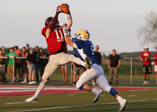 Licking Heights graduate Mitchell Coultas makes an interception during last Friday's Licking-Muskingum All-Star Game at Sheridan. The interception was nullified by a penalty, but Coultas helped Licking County grab a 27-21 victory.