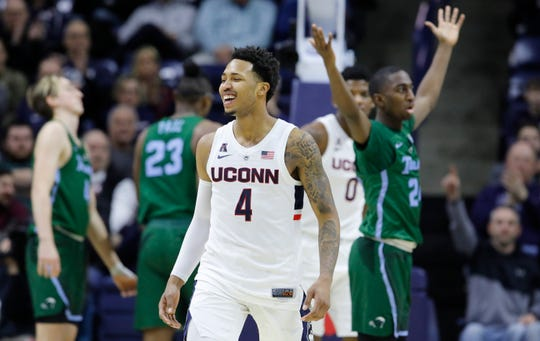 Huskies guard Jalen Adams reacts after a play against the Tulane Green Wave.