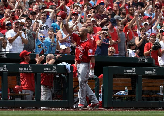 The Angels' Albert Pujols acknowledges the St. Louis crowd after hitting a home run against the Cardinals.