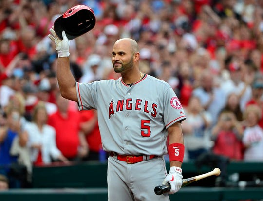 Albert Pujols acknowledges the crowd as he receives a standing ovation prior to his first at-bat as a visitor at Busch Stadium.