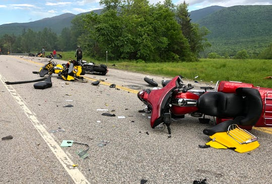 This photo provided by Miranda Thompson shows the scene where several motorcycles and a pickup truck collided on a rural, two-lane highway Friday, June 21, 2019 in Randolph, N.H.  New Hampshire State Police said a 2016 Dodge 2500 pickup truck collided with the riders on U.S. 2 Friday evening. The cause of the deadly collision is not yet known. The pickup truck was on fire when emergency crews arrived.