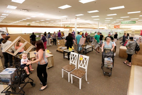 Customers shop during the final day of business at Shopko in Appleton on June 23, 2019.
